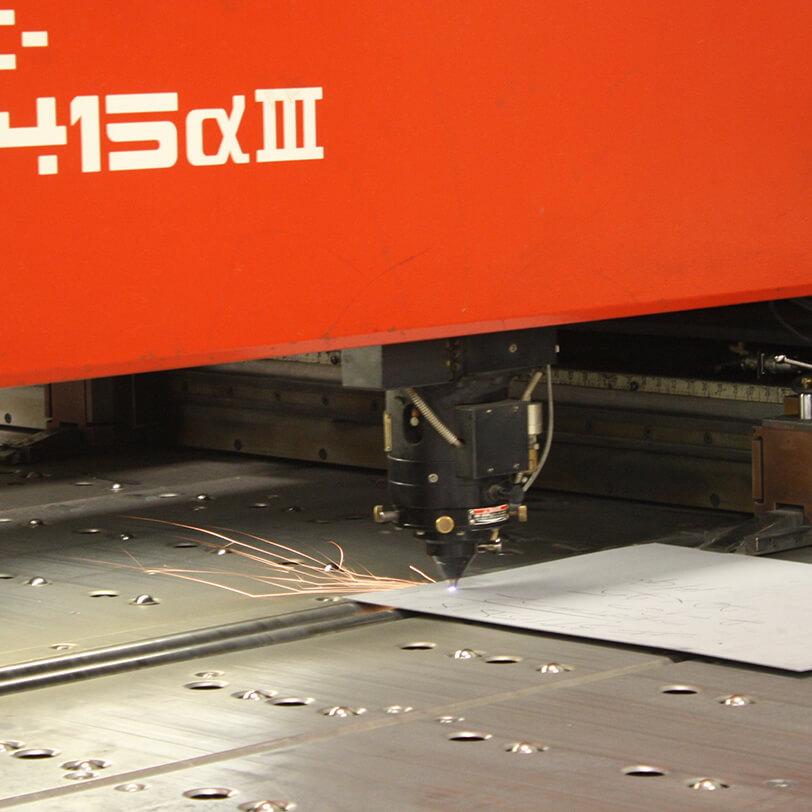Laser cutter cuts sheet of metal